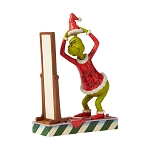 Universal Grinch by Jim Shore Figure - Grinch Dressing in Santa Suit